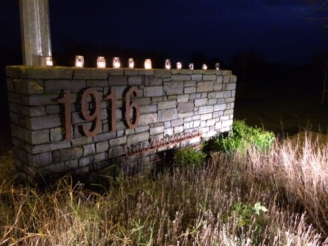 Candles placed at the entrance to the 1916 Memorial Garden in Cloughjordan